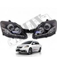 Фары линзовые, черные и светодиодной подсветкой для Toyota Yaris